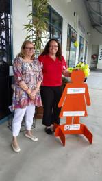 Day 11: Cr Victor Attwood's staff support Zonta Says NO by hosting an orange lady as she stands in silence at Redbank Shopping Centre.