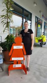 Day 12: Cr Victor Attwood's staff support Zonta Says NO by hosting an orange lady as she stands in silence at Redbank Shopping Centre.