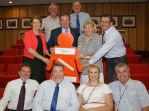 Day 5: Ipswich city Mayor Paul Pisasale and Councillors pose with an orange lady