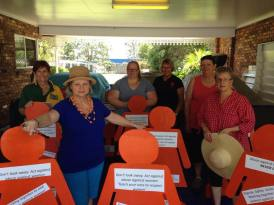 Zontians stand with the orange ladies ahead of the 16 Days of Activism