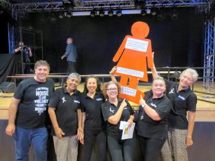 "Day 7: An orange lady appears with the cast of ""It all Begins with Love"" at the theatre for Creative Regions."